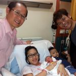 Dr Tan Poh Kok of PK Women's Specialist Clinic checking up on his patient and their newborn baby in the hospital
