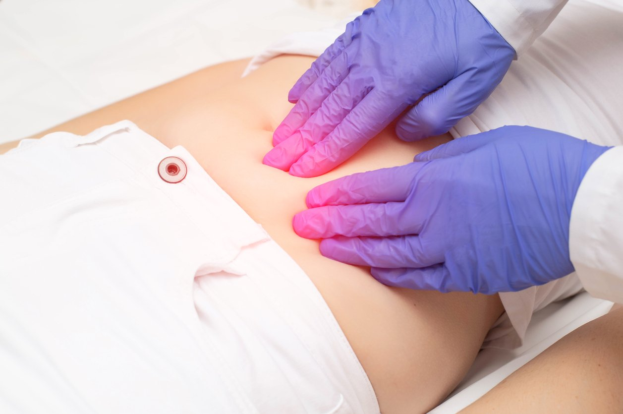 Doctor trying to examine for ovarian cysts