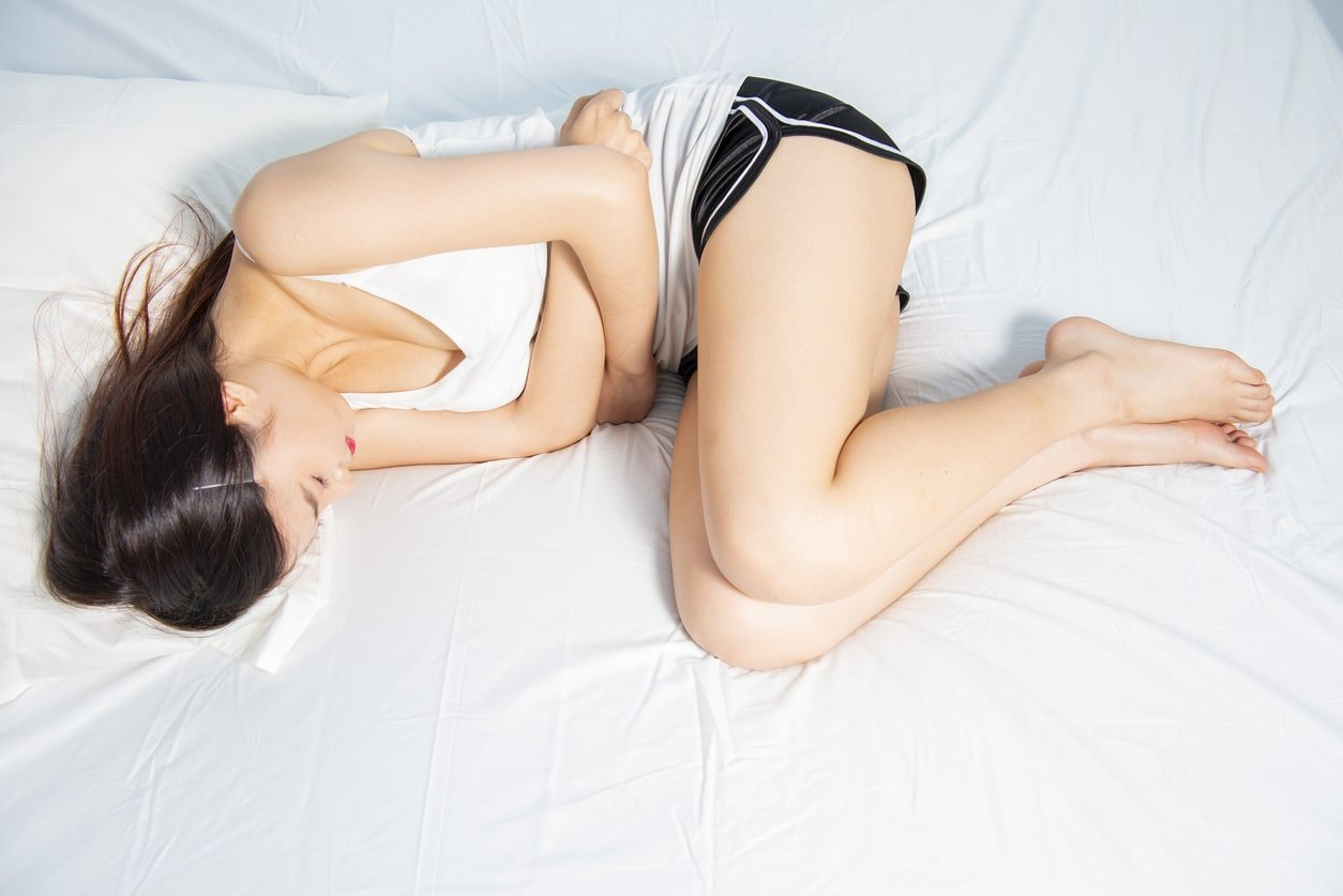Female suffering from menstrual pain